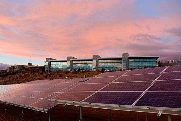 Monocrystalline solar panels in front of building